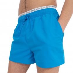 Short de bain court avec double ceinture - Bleu Ibiza - CALVIN KLEIN KM0KM00310-439